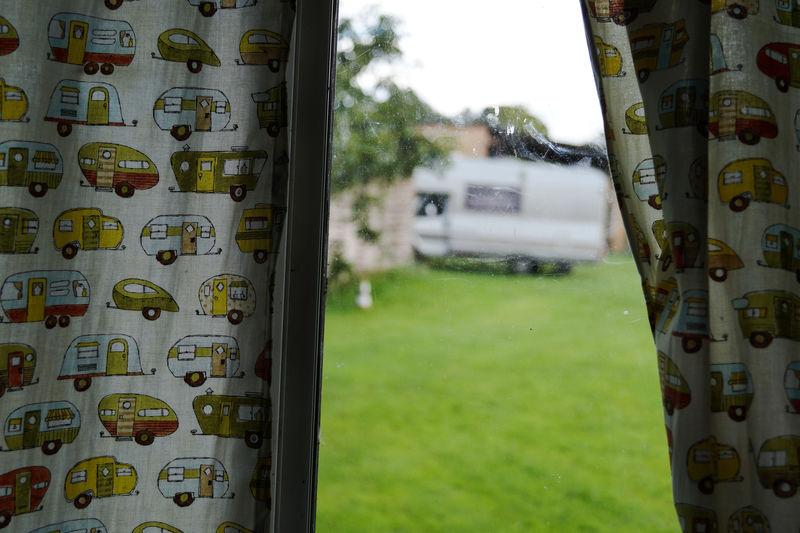 Camper Van Seen Through Window