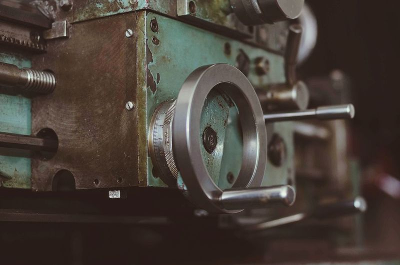 Close-up of old machine part in factory