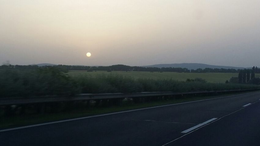 Dark Morning Sun Outdoors Nature No People Sky Cloudy Through Clouds Tree Dark Day Nothing Special Travel On The Road Way Tired Driving