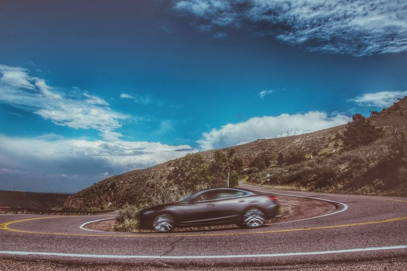 EyeEm Selects Car Landscape No People Mountain Sky Sports Track Outdoors Nature Day Auto Road Turn Speed Mountains