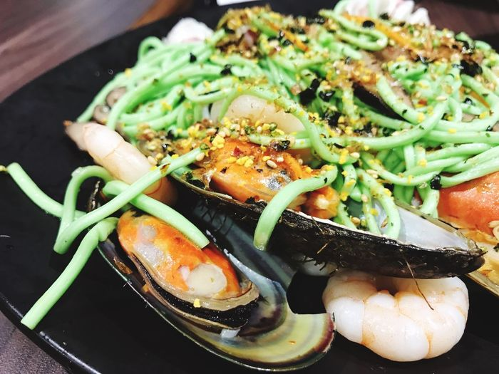 Close-up of seafood served in plate on table