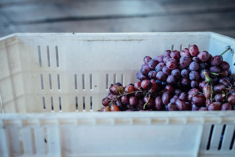 Close-Up Of Red Grapes In Crate