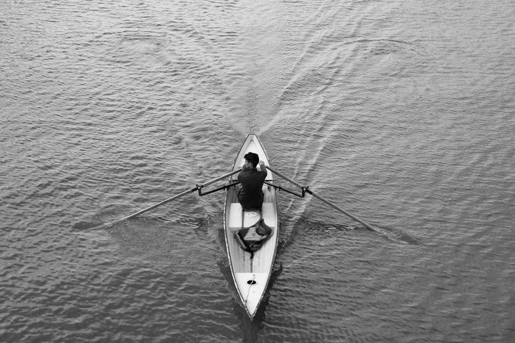 High Angle View Of Man On Boat Sailing In River