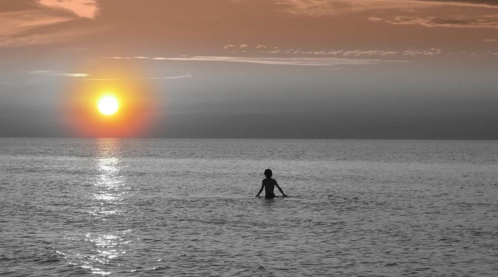 Twilight PerfectSunsetLone Person in the Water SwimPinery Provincial Park Ontario Canada