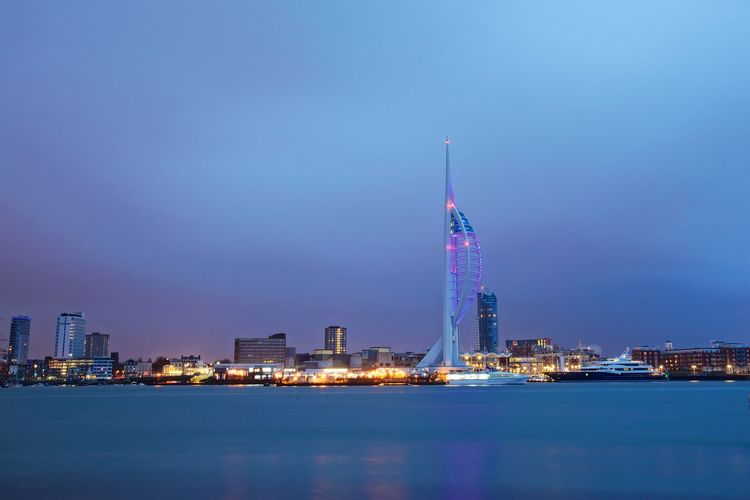 Mouth city water front early morning. Portsmouth Architecture Building Exterior Built Structure Sky Illuminated Tall - High Waterfront City Travel Destinations Building Tower Office Building Exterior Water Travel No People