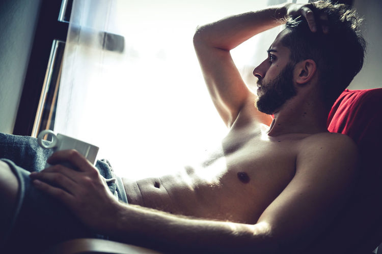 Casual Clothing Communication Cup Hair Holding Home Indoors  Lifestyle Light Man Modern Person Relax Relaxation Relaxing Moments Sitting Style Time For Breakfast  Time To Reflect Window Young Adult People Watching People And Places EyeEm Best Edits Always Be Cozy
