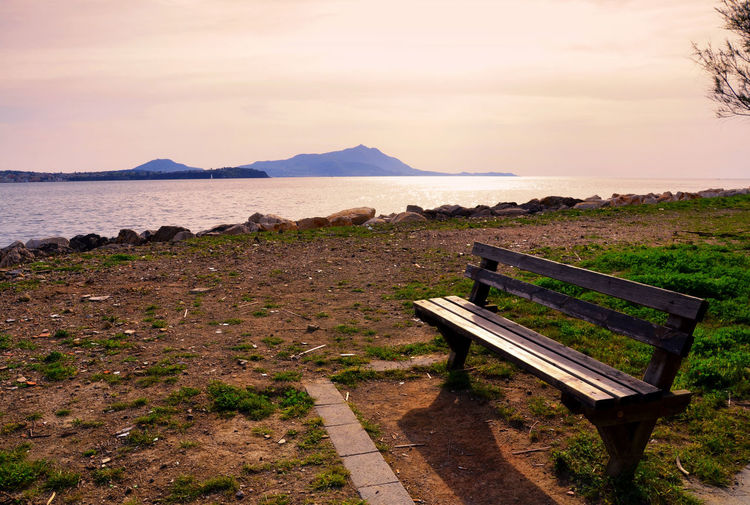 The Bench On The Sea. Absence Beauty In Nature Bench Calm Cloud Cloud - Sky Empty Grass Idyllic Lakeshore Landscape Mountain Mountain Range Nature Outdoors Relaxing Scenics Showcase April Sky Taking Photos Tranquil Scene Tranquility Water Weekend Welcomeweekly