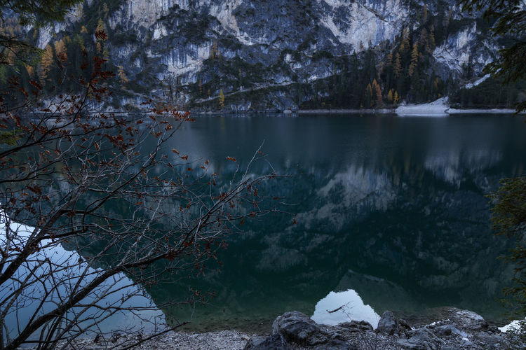 Scenic view of lake in forest during winter at lago di braies