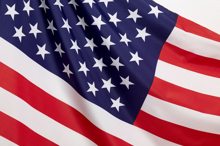 Close-up of american flag against white background