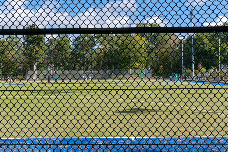 Field Barrier Baseball - Sport Boundary Chainlink Fence Close-up Day Empty Fence Focus On Foreground Hockey Hockey Field Land Nature No People Outdoors Plant Protection Safety Seat Security Sport Tennis Tree
