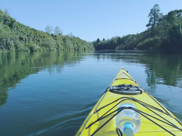 The Color Of Sport Water Kayak River Travel Destinations Personal Perspective Boat Yellow Beauty In Nature Nature Transportation
