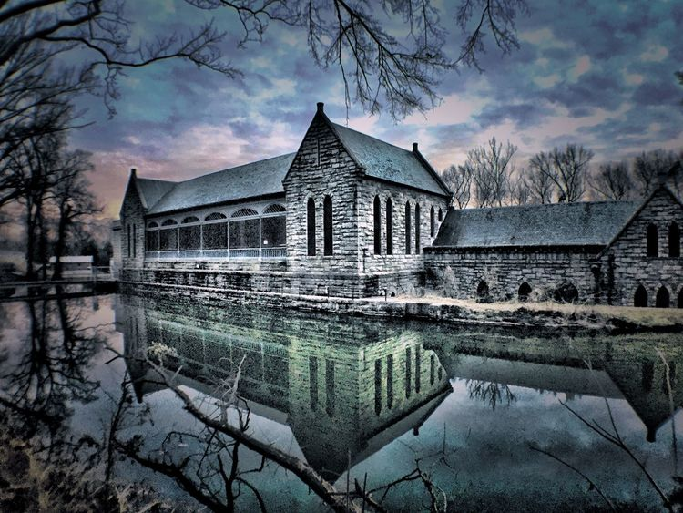 Reflections of the past. Water Built Structure Architecture Reflection Building Exterior Tree Nature No People Bare Tree Winter Waterfront Sky House Cold Temperature Watermill Outdoors Beauty In Nature Lake Tranquility Reflection Lake RVA Pumphouse Canal Canal Walks Still Water The Architect - 2017 EyeEm Awards