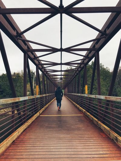 Bridge - Man Made Structure Connection The Way Forward One Person Real People Rear View Footbridge Architecture Built Structure Railing Day Transportation Covered Bridge Walking Backview Bridge Outdoors Full Length Lifestyles Clear Sky Elora Ontario Walking Bridge The Great Outdoors - 2017 EyeEm Awards