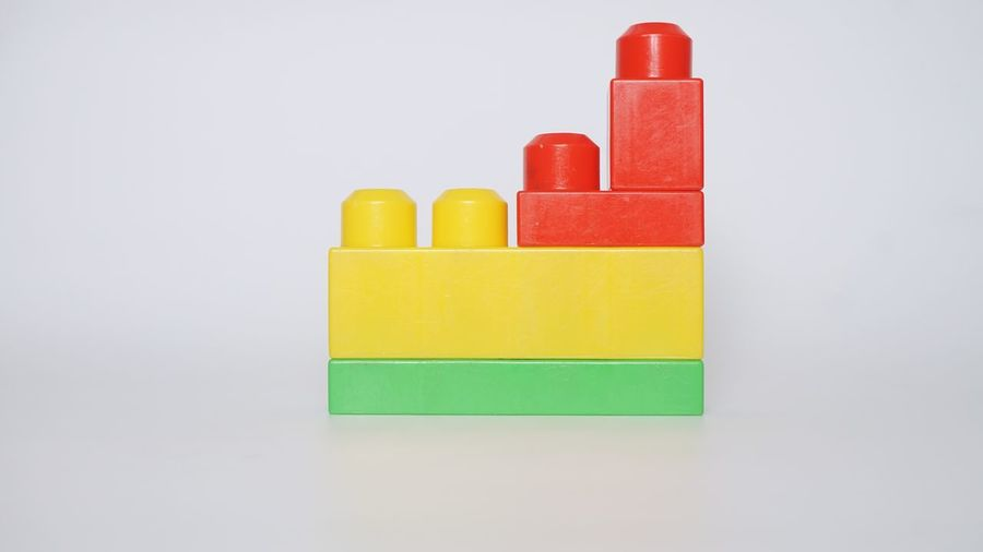 Close-up of multi colored toy against white background