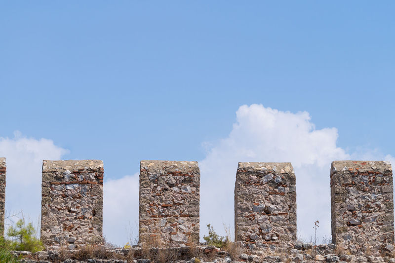 Low Angle View Of Alanya Castle Stone Wall Against Sky