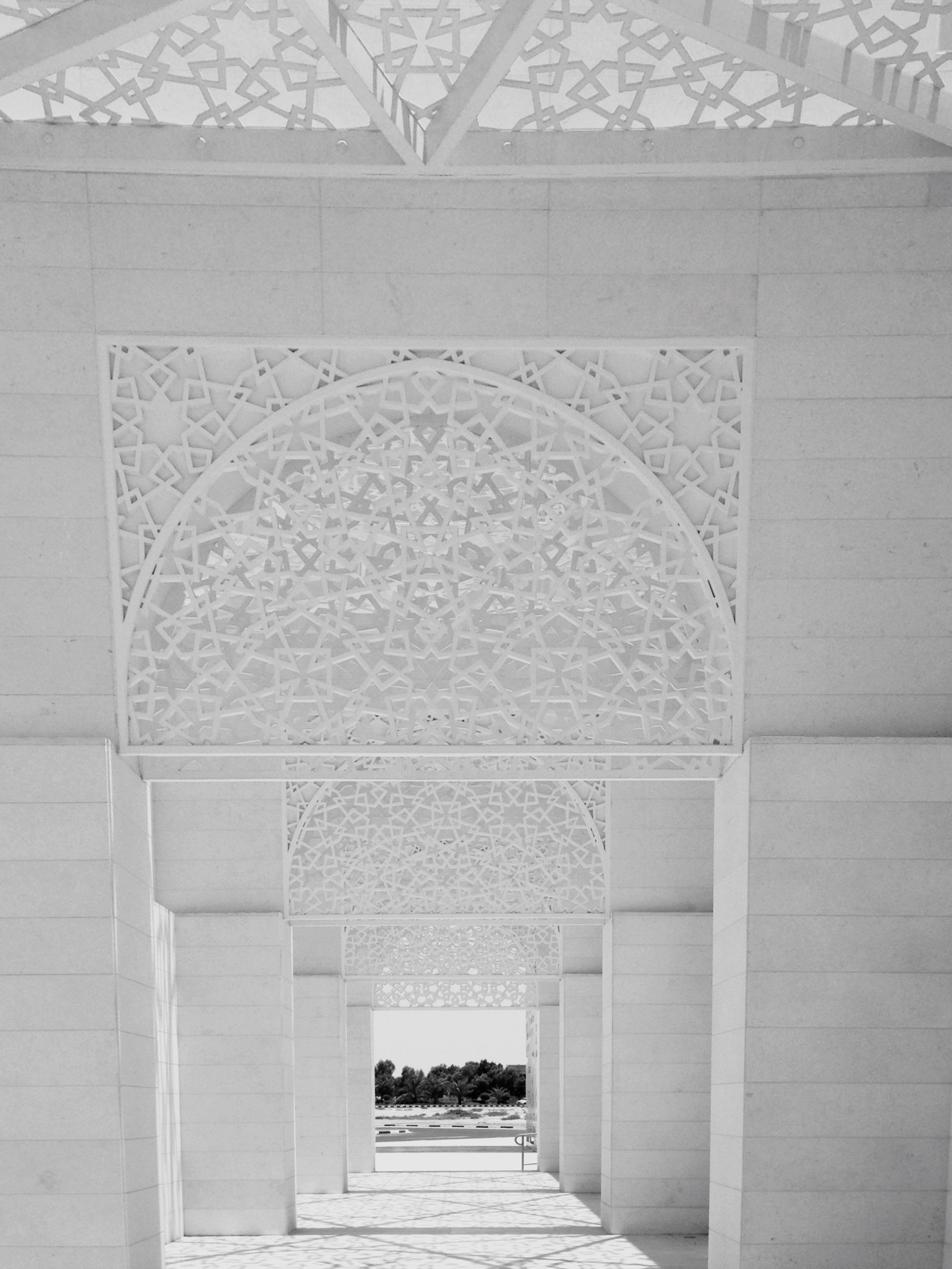 architecture, built structure, building exterior, history, the way forward, wall - building feature, entrance, steps, arch, pattern, stone material, day, indoors, art and craft, art, architectural feature, design, building, old, historic