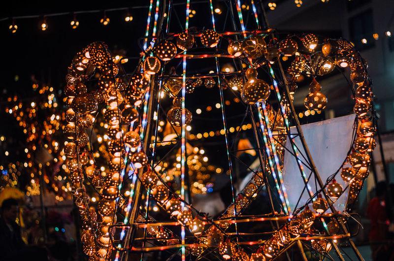 Illuminated christmas decorations at night