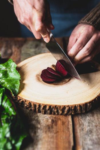 Close-up of man preparing food on cutting board