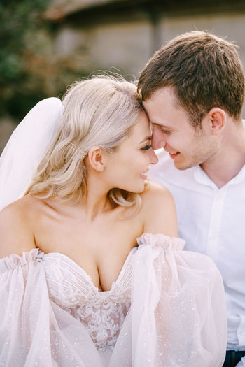 Couple embracing during wedding ceremony outdoor