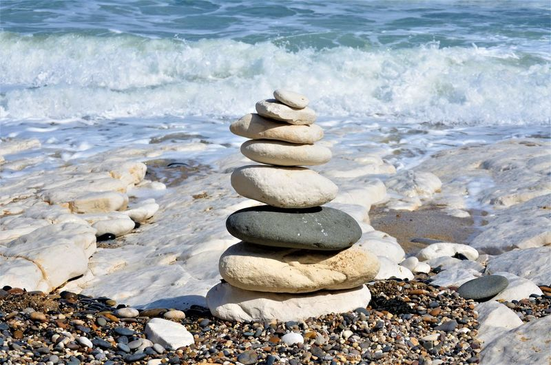 Stone - Object Rock Solid Balance Beach Stack Water Stone Pebble Zen-like Land Sea Nature Rock - Object Tranquility Day Beauty In Nature Wave No People Outdoors