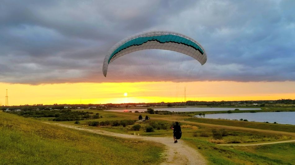 Paraglider Leisure Activity Landscape Sky Parachute Sunset Cloud - Sky Flying Full Length Outdoors Adventure Multi Colored Scenics Sport Vacations One Person Nature Grass Fun Saltlife Sarasota Florida Clouds In The Sky Celery Fields Peaceful View