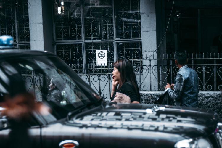 Men on car in city