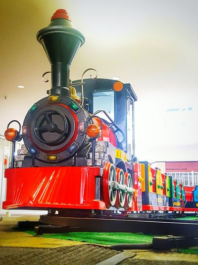 All Aboard A Pint Size Bright Little Train Trains Train Ride At The Mall Indoors  Abstract Colorful Abundance Rides From My Point Of View Fine Art EyeEm Perspective ForTheLoveOfPhotography Eyeemphotography Eye4photography  Fun Times! Interior Views Kids Zone Tiny
