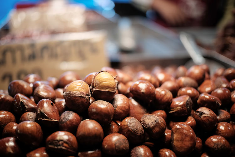 Chestnuts in market. Food And Drink Food Brown Large Group Of Objects Still Life Nut - Food Market Retail  For Sale Freshness Nut No People Chestnuts