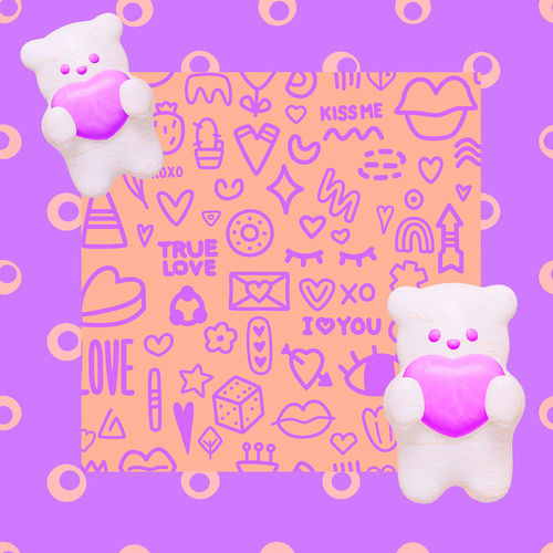 Close-up of pink toys against colored background