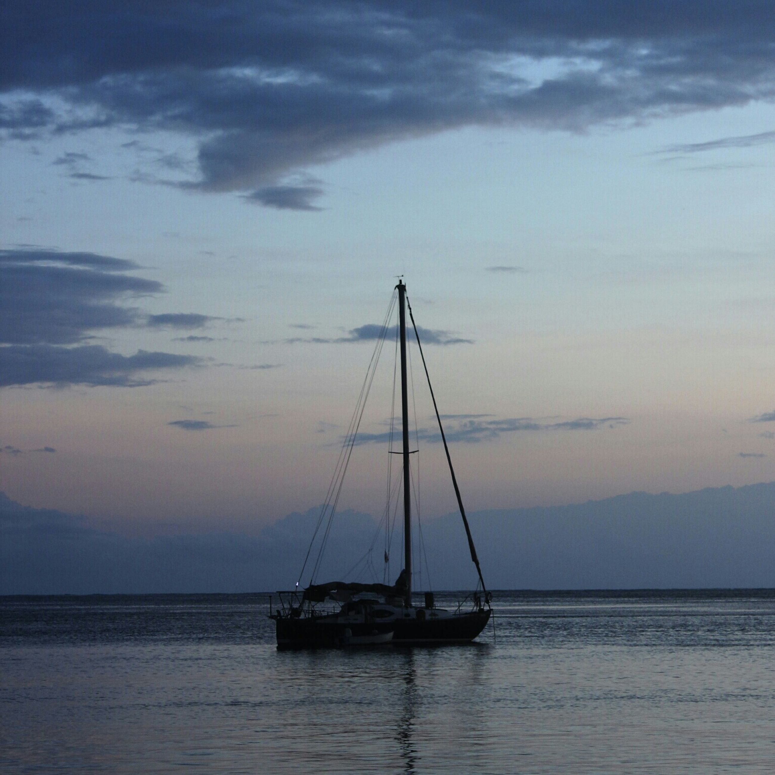 sea, nautical vessel, water, transportation, boat, mode of transport, sky, horizon over water, tranquility, tranquil scene, scenics, sunset, sailboat, beauty in nature, waterfront, mast, nature, sailing, silhouette, cloud - sky