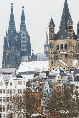 St. Martin und Kölner Dom im Winter Architecture Cathedral Church City Cityscape Clock Tower Cold Temperature Cologne Day History Köln Kölner Dom No People Outdoors Place Of Worship Religion Sky Snow Tower Travel Destinations Winter