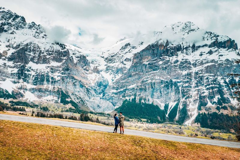 Couple looking at snowcapped mountain