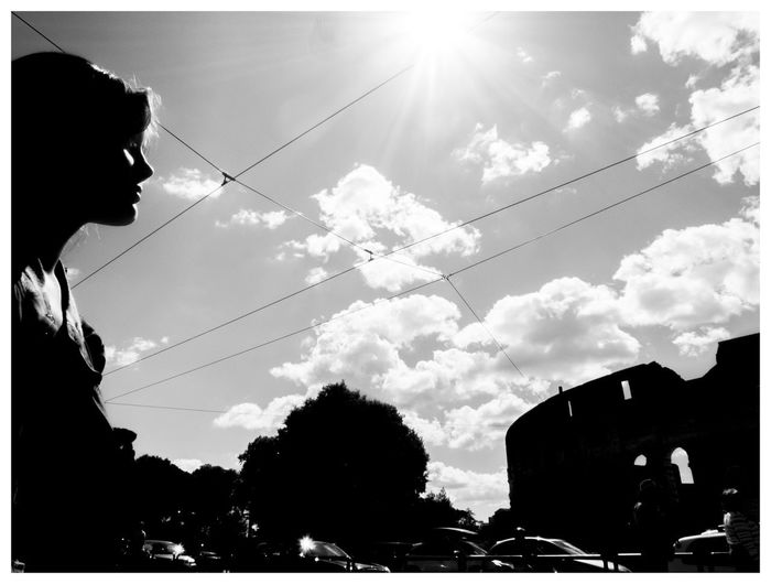 Side view of silhouette man against cloudy sky