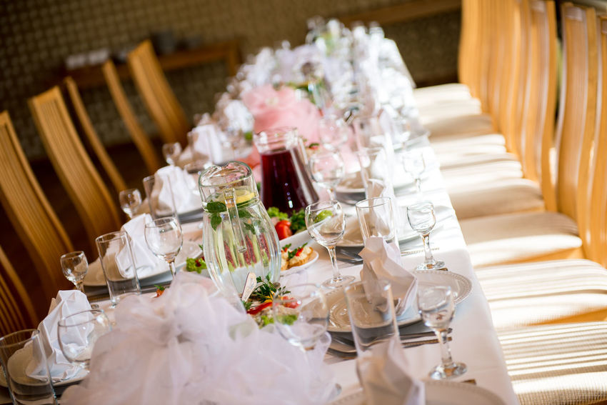 Wedding table setting at restaurant Banquet Empty Chairs Holiday In A Row Romance Table Setting Table Arrangements Wedding Wedding Reception Celebration Event Decorated Empty Indoors  No People Nobody Place Setting Restaurant Serving Size Table Tablecloth Wedding Banquet Wedding Chairs Wedding Table