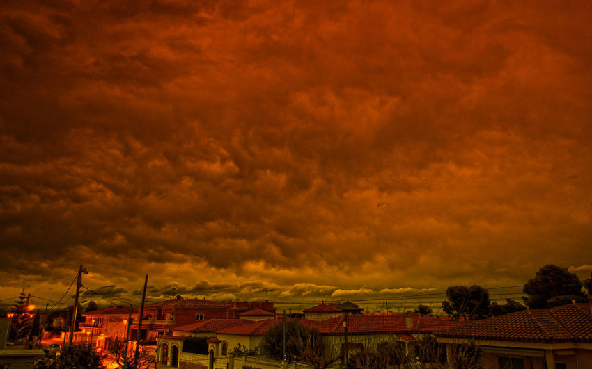 Atmosphere Atmospheric Mood Cloud Cloud - Sky Cloudscape Cloudy Community Dramatic Sky Human Settlement Moody Sky Orange Color Outdoors Overcast Residential District Silhouette Sky Storm Cloud Sunrise In Miami Platja-Tarragona Sunset