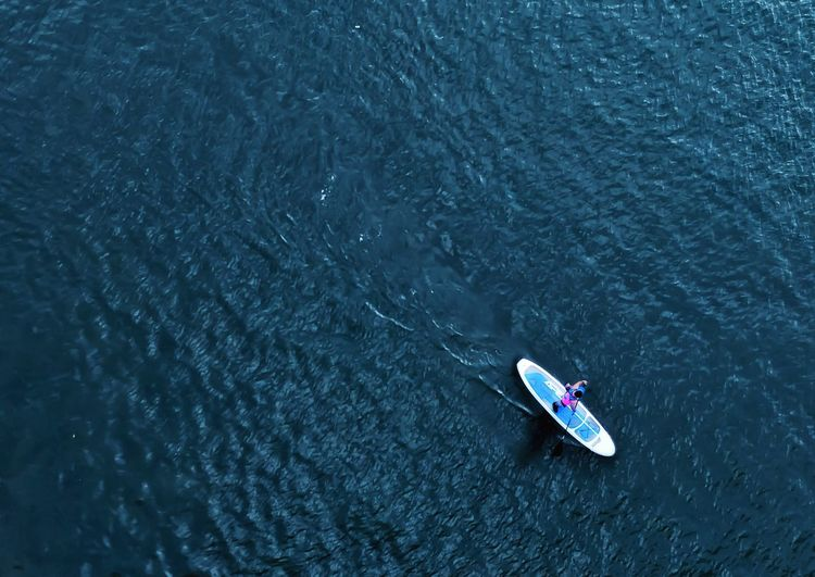 High angle view of person paddleboarding in river