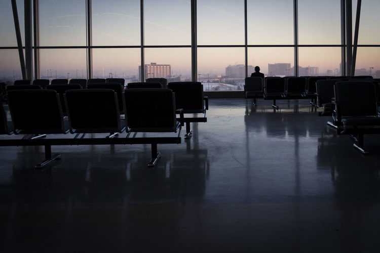Airplane Airport Airport Departure Area Chair Contemplation Day Flight Fly Indoors  Let's Go. Together. Reflection Seat Silhouette Sky Sunrise Transit Travel Waiting Waiting Room Window Winter Breathing Space