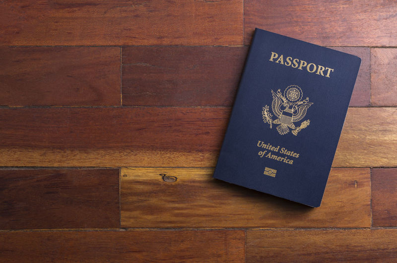Close-up of passport on wooden table