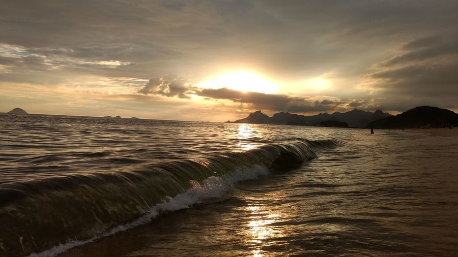 Sunset at piratininga beach Sunset Water Wave Sea Nature Dramatic Sky Beach Beauty In Nature Outdoors Cloud - Sky Sand Scenics Landscape Refraction Horizon Over Water Beauty In Nature EyeEmNewHere