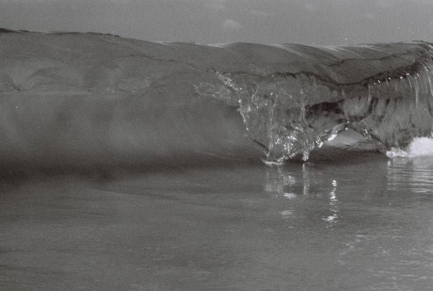 a day at the beach Film Photography Filmisnotdead Blackandwhite Black And White Blackandwhite Photography Water Waterfront Nature Reflection Lake Beauty In Nature Day Mountain No People Motion Cold Temperature Outdoors Winter Ice Environment Scenics - Nature Landscape Frozen Melting Iceberg Purity