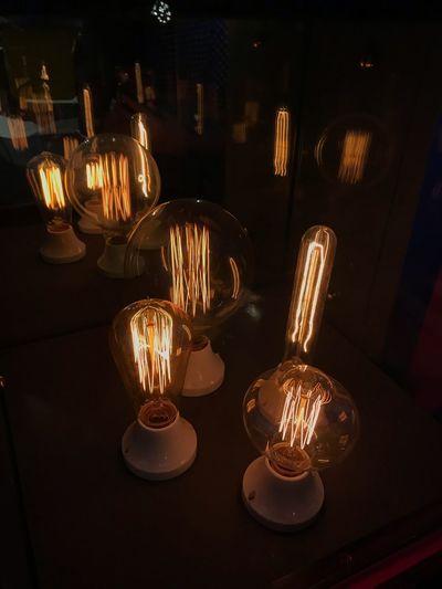 Close-up of illuminated light bulbs on table