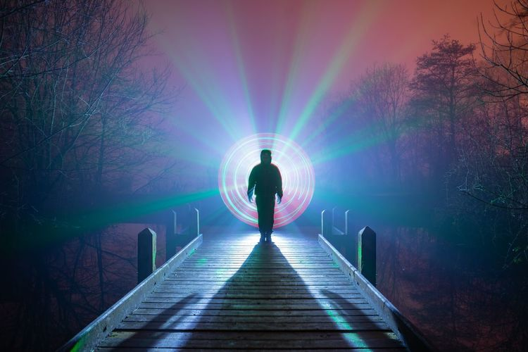 Full Length Men Illuminated Silhouette Standing Rear View Binary Code Cyberspace Footbridge Pixelated Artificial Intelligence Symmetry Light Painting