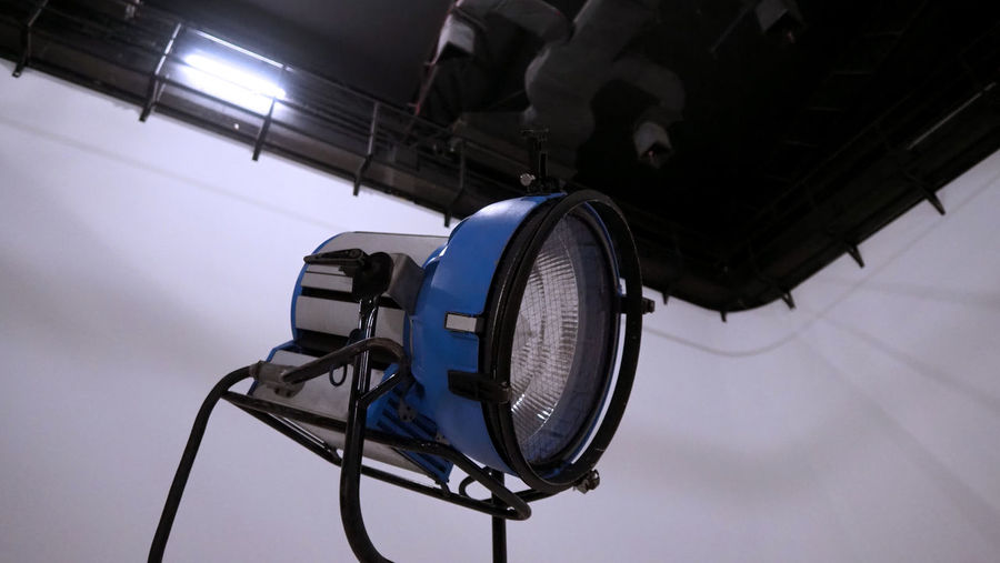 Low angle view of lighting equipment hanging at ceiling
