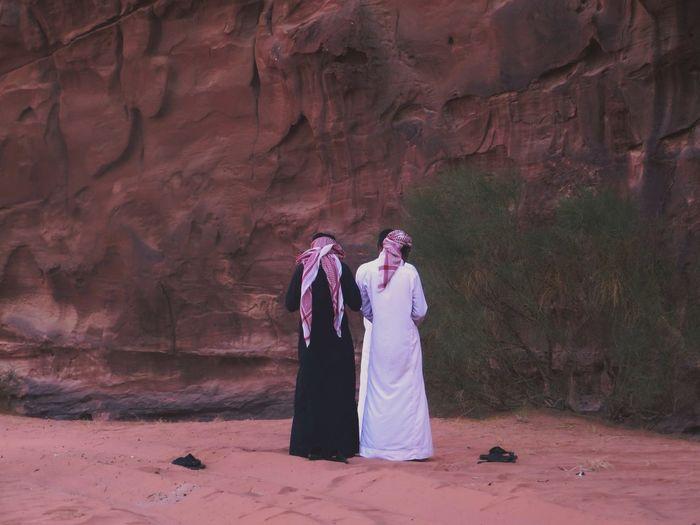 Rear view of people in desert