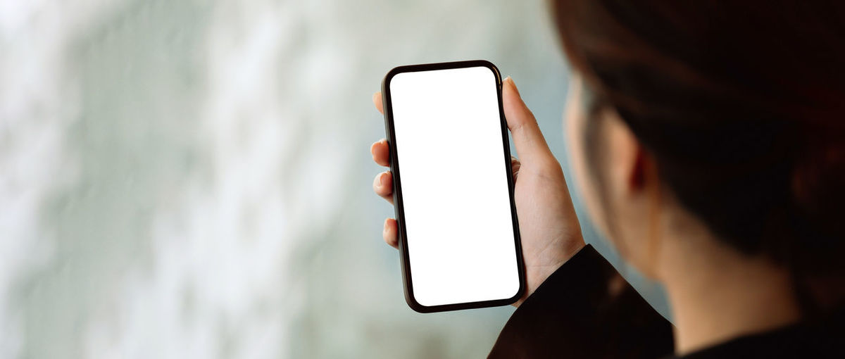 Close-up of woman holding smart phone