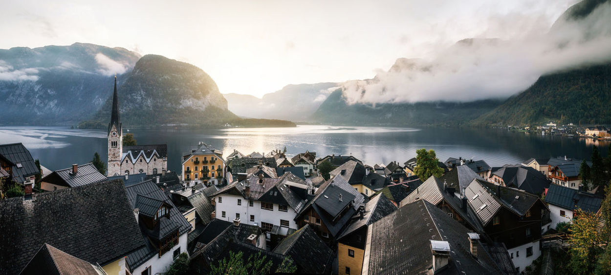 Panoramic scenic view of famous Hallstatt town reflecting in Austrian Alps in morning light in autumn at sunrise, Salzkammergut region, Austria Austria Austria ❤ Architecture Building Exterior Built Structure Cloud - Sky Hallstatt Mountain Mountain Range Nature Outdoors Residential District Scenics - Nature Travel Destinations Water