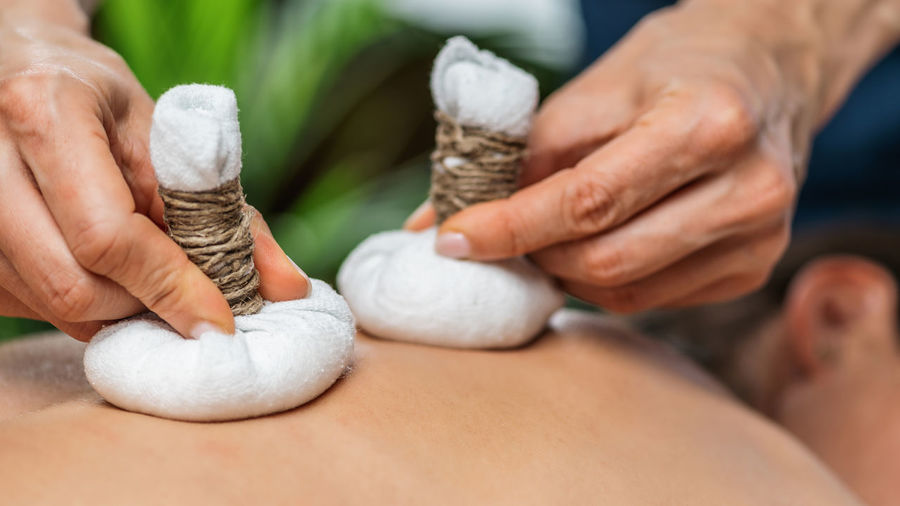Ayurvedic massage with kizhi or herbal bags made from various dried herbs wrapped in cotton