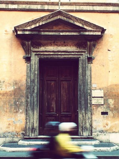 capturing motion Built Structure Architecture Building Exterior Entrance Day Outdoors No People Old Door Doorway Doorporn Entrance Blurred Motion Vespa Italy Rome Capital Cities  Architecture Doors From The Past Roma Character Travel Destinations Door Old Buildings Closed