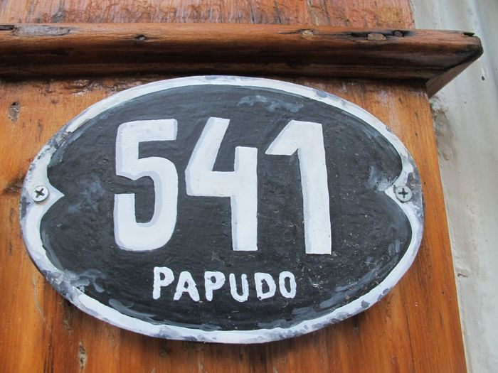 Papudo Number Communication Text Western Script Sign Wood - Material Day Close-up No People Metal Number White Color Wall - Building Feature Information Outdoors Information Sign Geometric Shape Warning Sign High Angle View Entrance Transportation