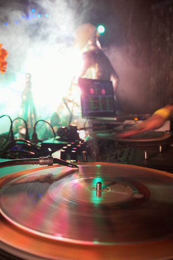 I took this pic during a party i use to cover. Arts Culture And Entertainment Close-up Club Dj Colors Dj Dj Illuminated Indoors  Lens Flare Lights Long Play LP Music Night Nightclub Nightlife Party Record Spin Spinning Turntable Vinyl